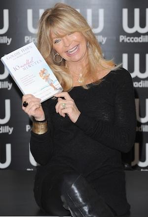 Goldie Hawn leaves London club looking drunk.