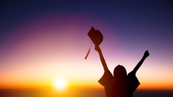 silhouette of Student Celebrating Graduation watching