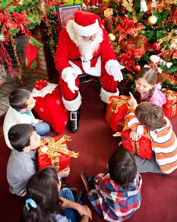 group of children meeting santa
