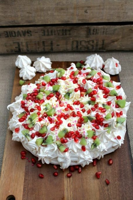 Winter fruit desserts: Crispy pavlova, fluffy cream, and fruit make this dessert