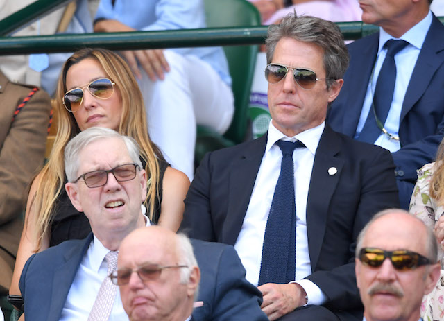 Anna Eberstein and Hugh Grant attend the men's single final on day thirteen of the Wimbledon Tennis Championships