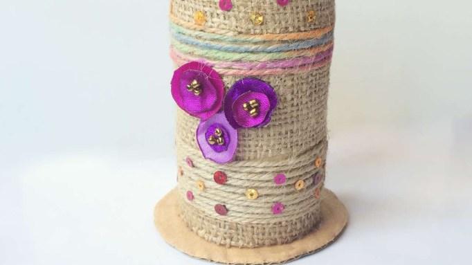 Toilet paper roll vase