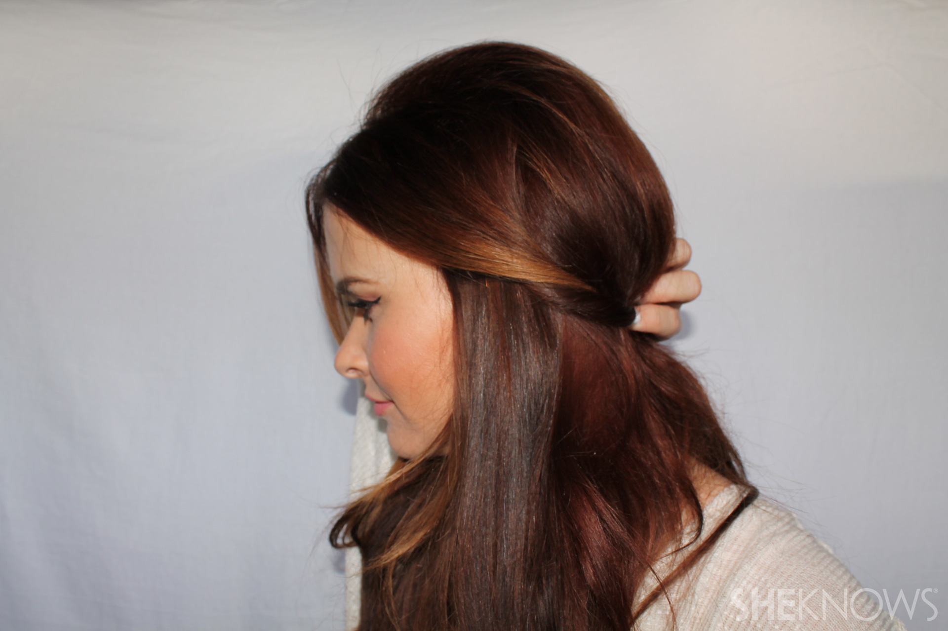 Chic Half up Half down Step 4: pin a little above the nape of your neck