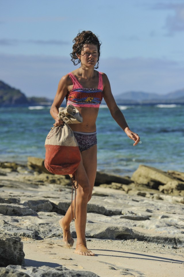 Hali Ford walks along Mana beach on Survivor: Game Changers