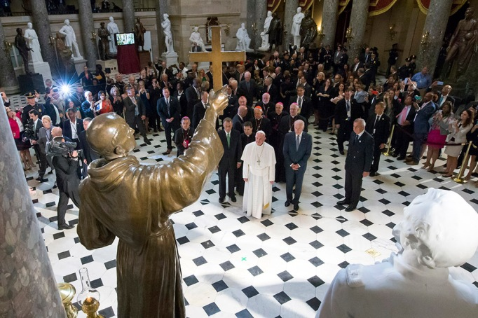 Pope Francis pauses in front of a sculpture of Spanish-born Junipero Serra