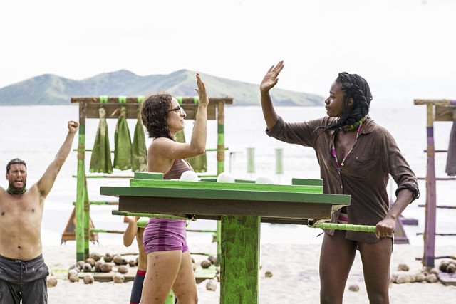 Hannah Shapiro high fives Michaela Bradshaw after challenge on Survivor: Millennials Vs. Gen-X