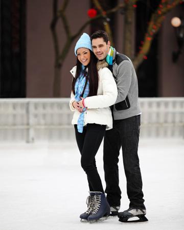 Happy couple ice skating