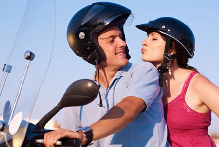 Happy couple on motorcycle