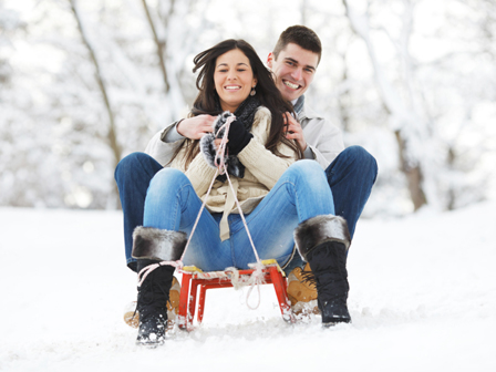 Happy couple on sleds