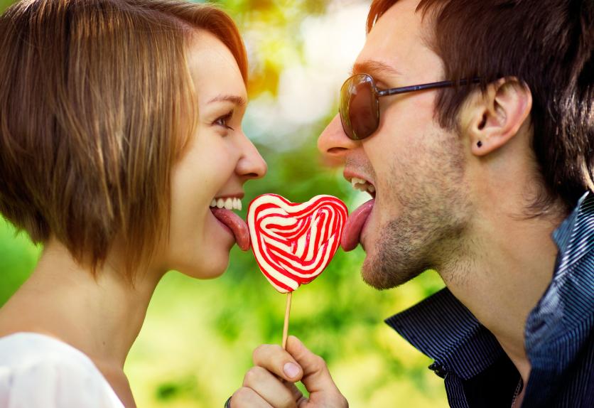 happy couple sharing lollipop