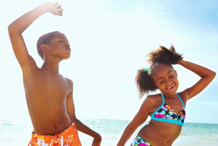 Happy kids wearing bathing suits