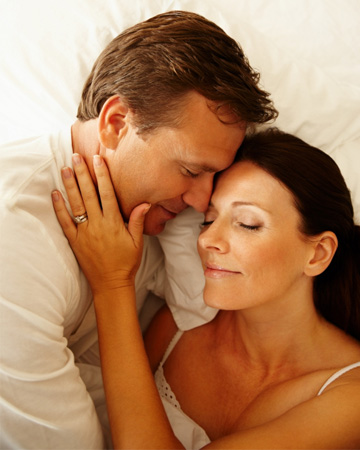 Happy mature couple in bed