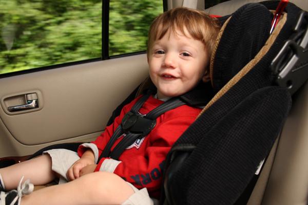 Happy preschooler in a car