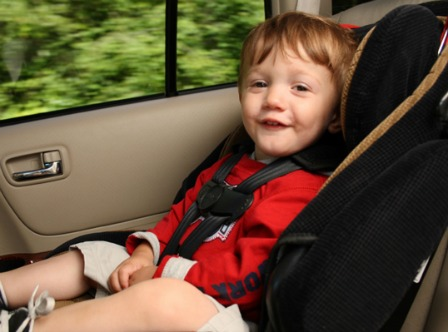 Happy kid in a car seat