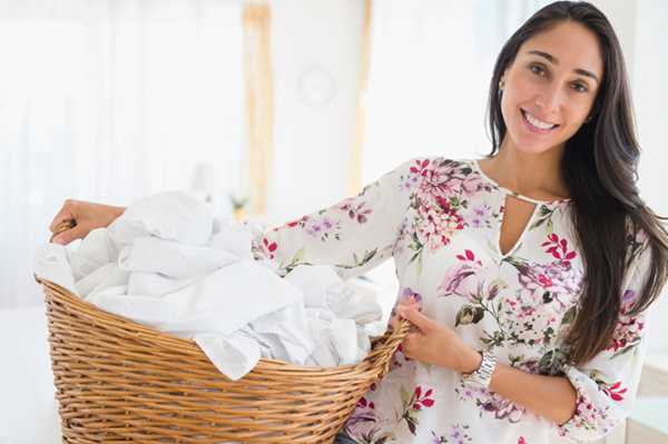 Happy woman doing laundry