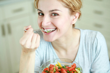 woman eating acidic foods