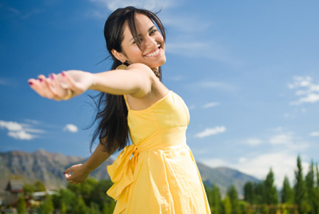 Happy woman in a summer dress