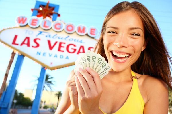 Happy woman in front of Las Vegas sign