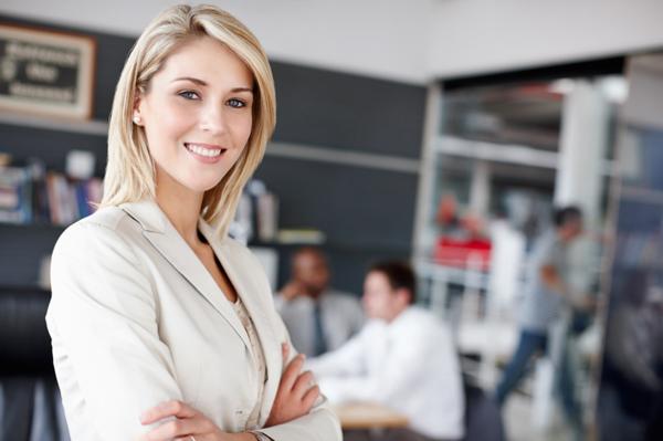 Happy woman in office