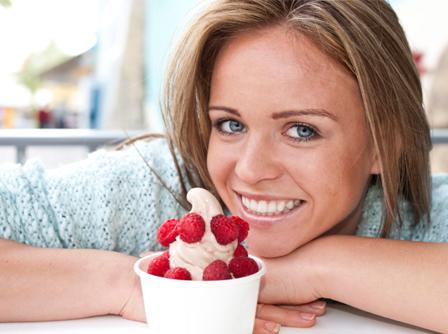 Happy woman with frozen yogurt