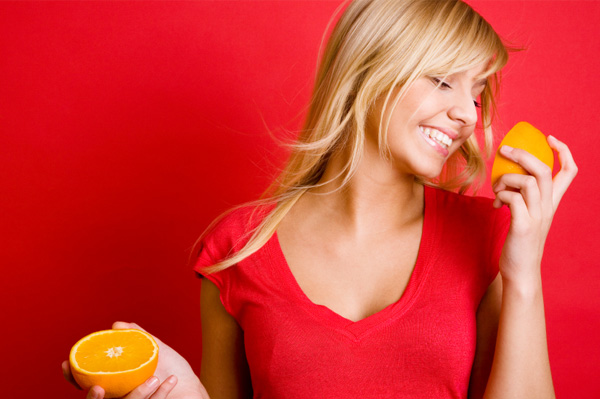 Happy woman with oranges