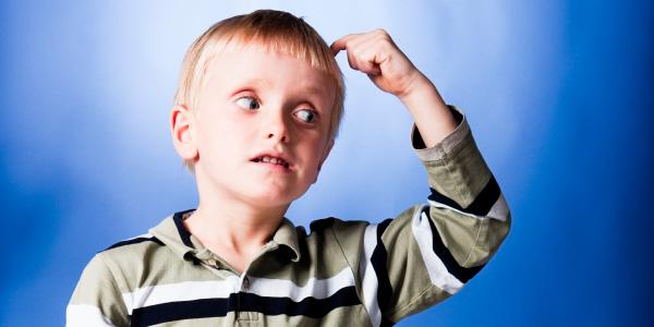Child Scratching Head