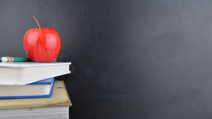 A classroom with a red apple,