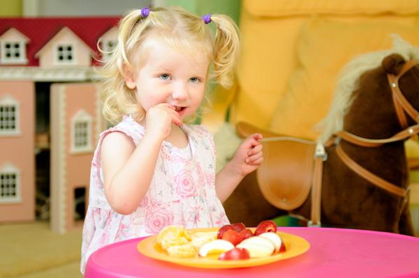 Girl Eating Fruit