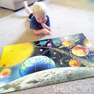 Logan playing with floor puzzle