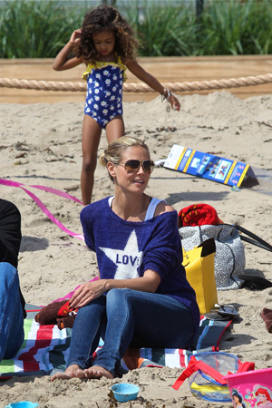 Heidi Klum and her kids on a beach