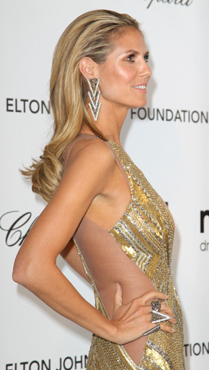 Heidi Klum showing side butt