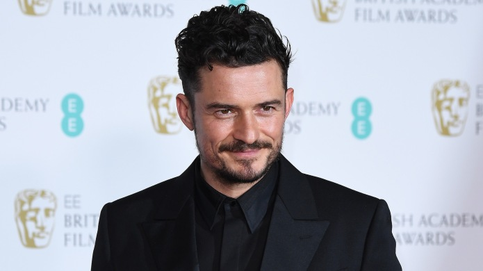 Orlando Bloom poses in the press