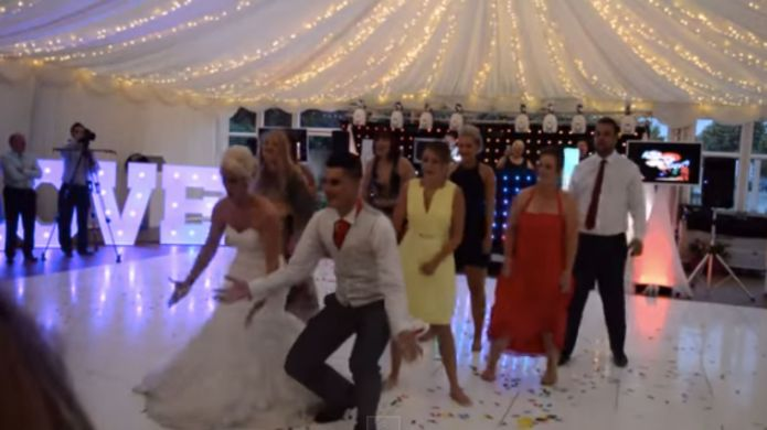 Newlyweds give their first dance a