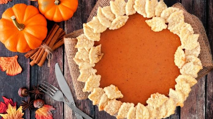 Thanksgiving pumpkin pie with autumn leaf