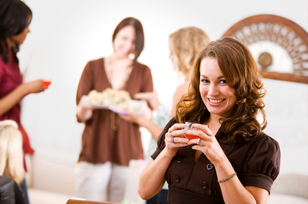 hostess drinking punch at party