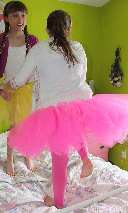 girls jumping on bed in tutus