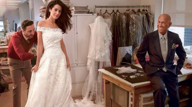 Amal Clooney poses in a fashion shot during her wedding dress fitting with Oscar de la Renta