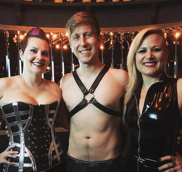 Tristan Taormino poses with two people at a sex education and play event