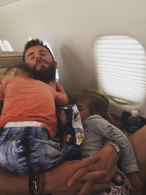 Chris Hemsworth and kids on plane