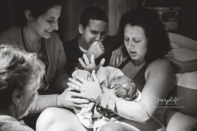 Childbirth photography: New parents overcome with emotion as they greet their child