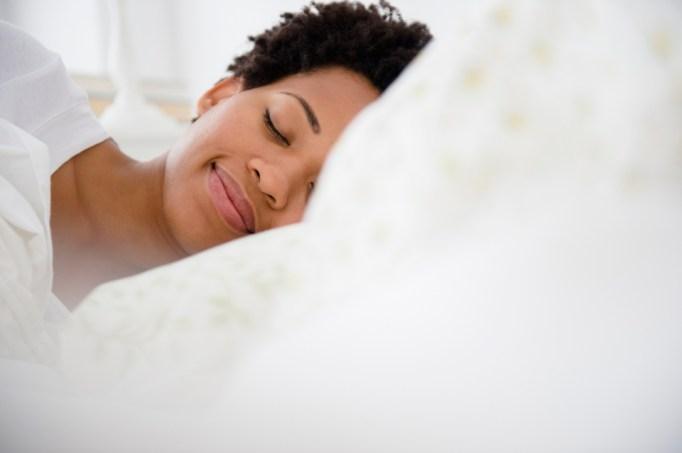 Woman sleeping on pillow