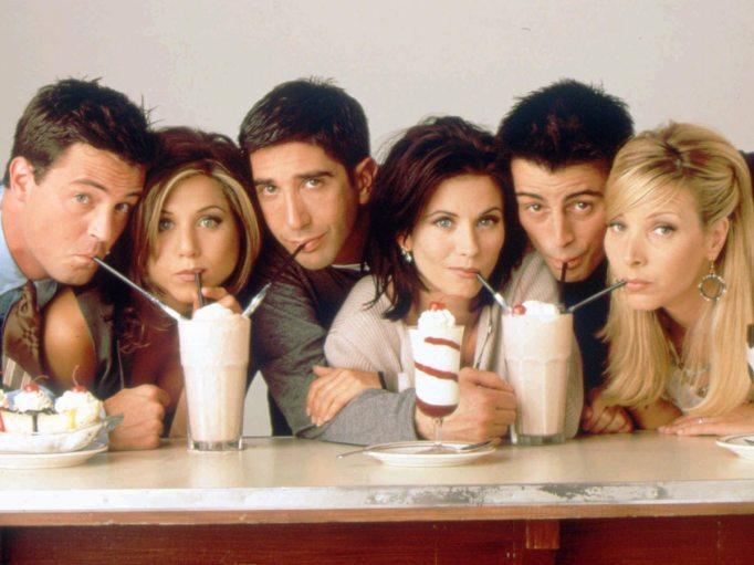 Friends cast sharing milkshakes