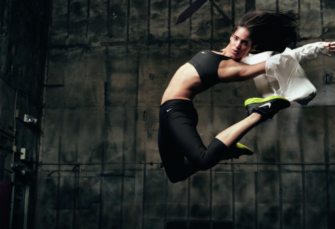 Sofia Boutella jumps up in the air for a Nike advertisement