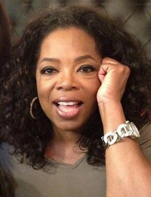 Oprah locks lips with another man,