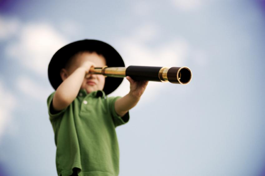 boy with scope, blue sky, boy looking through monocular