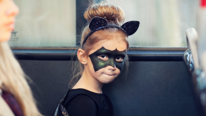 Girl in a bat costume for
