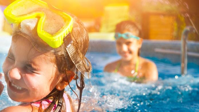 Two Girls Playing, Splashing and Laughing