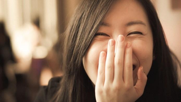 Women smile begins to spill.