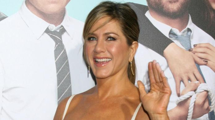 Jennifer Aniston poses topless, calls men
