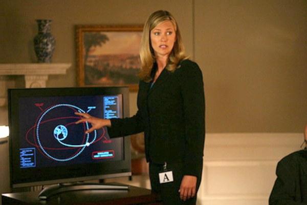 Natasha Henstridge briefs the president in Impact